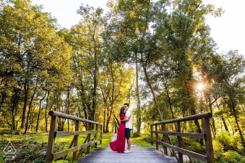 Lago di Cavazzo, Friuli Venezia Giulia, Italy outside forest picture session before the wedding day In the green trees on a wooden bridge