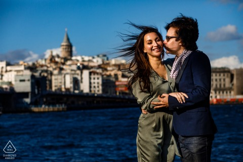 Istanbul urban pic shoot before the wedding day by the water with the city skyline and some wind