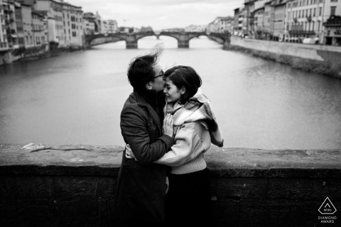 Italian couple engagement pic session on the Ponte Vecchio in Florence