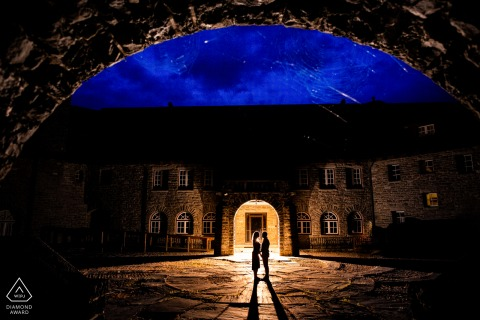 Albany, NY couple pre-wed portrait using A twilight silhouette in an abandoned castle courtyard