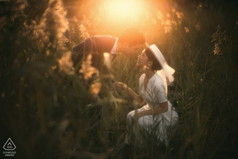 Guangdong couple pre-wed portrait created as they Touch each other in the sunlit fields