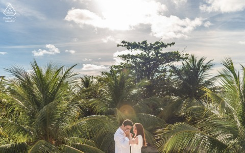 Alagoas engaged couple picture session at Sao Miguel dos Milagres while the soon to be Groom kisses his wifes hand among coconut trees