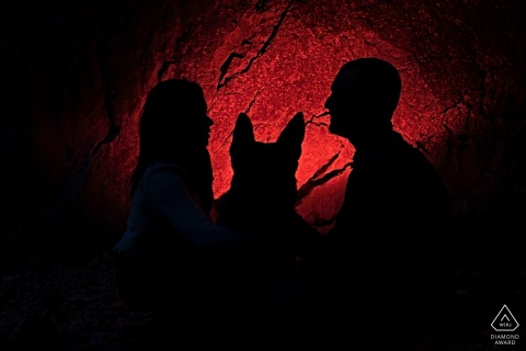 Cazorla pre - wed image showing silhouettes and shadows on the red walls of the cave