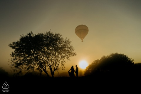 Boituva couple pre-wed portrait with a solo hot air balloon in the sky overhead