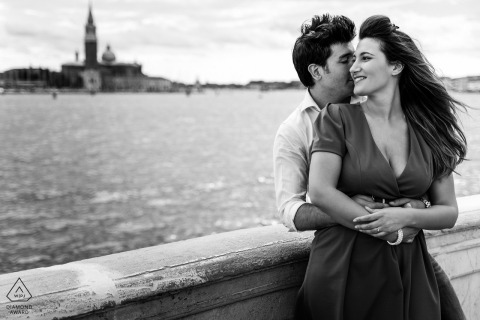 Venice couple engagement pic session showing their Windy love in BW