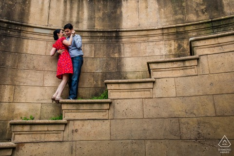 San Francisco pre - wed image with a couple hanging onto love on the steep steps