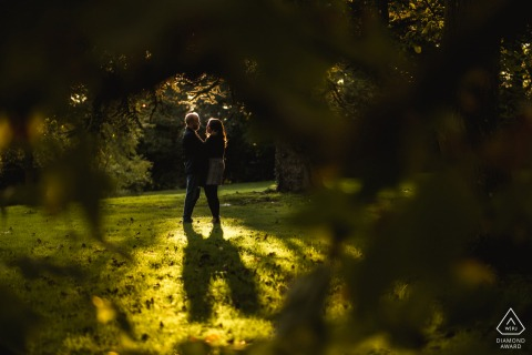 Mottisfont engaged couple picture session in the sunlight framed in the green trees