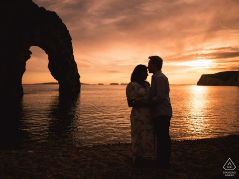 Durdle Door couple pre-wed portrait before an England wedding...by the sea at sunset