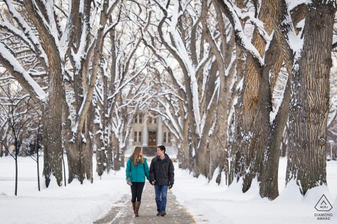 Fort Collins engaged couple picture created while Strolling under the giant elm trees at Colorado State University during a snowy winter session