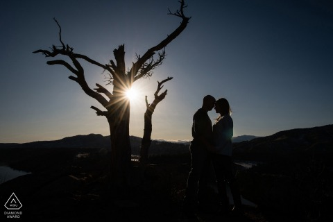 Fort Collins couple engagement Silhouette portrait with the fading sun looking towards the Rocky Mountains