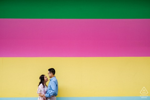 Houston, TX Fine Art Pre Wedding Portrait against a boldly painted colorful wall in the city