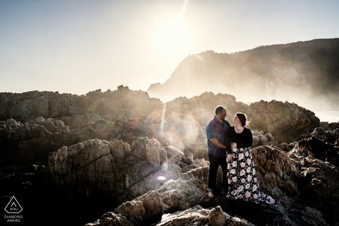 Knysna Fine Art Engagement Image showing  The spray of the ocean waves in the wind makes for great aesthetics in this engagement photo