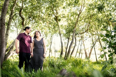 Majic Forest, Cape Town Fine Art Pre Wedding Portrait created as The happy couple shares a laugh in the beautiful green forest