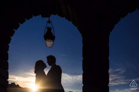 Paris Fine Art Engagement Session at sunset under the brick arches and single hanging lantern