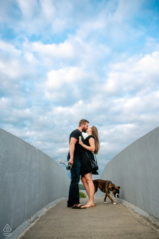 Westport Lookout Point Fine Art Pre Wedding Portrait for the Ontario Couple standing on a bridge eating ice cream and walking their dog