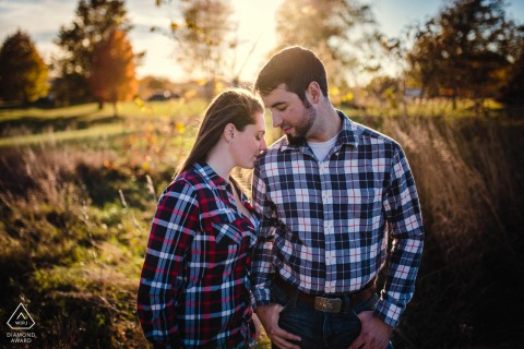 Lincoln, IL Artful Engagement Picture at a family farm as the couple is Resting into each other during the sunset