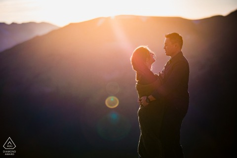 Rocky Mountain National Park Fine Art Pre Wedding Portrait for Engaged Colorado couple laughing together in the sunset
