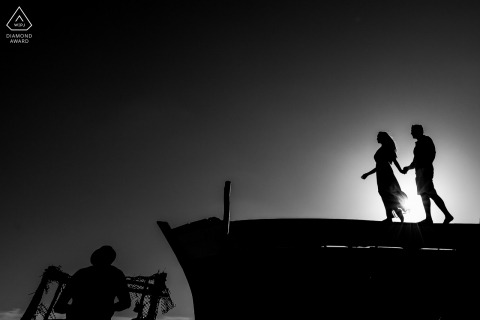 Japaratinga Fine Art Pre Wedding Portrait in BW with a silhouette couple standing on the ledge