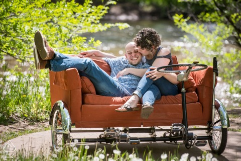 Fort Collins Artful Engagement Picture with a Couple lounging on their bicycle couch