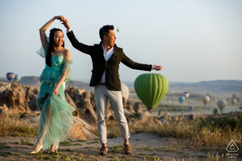 Cappadocia Fine Art Engagement session at the sunrise with hot air balloons