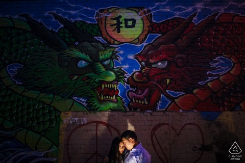 China Town Fine Art Engagement Image in San Francisco showing the Night of the Dragons overhead