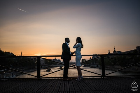 Paris Montmartre Fine Art Engagement walking session on the bridge over the water at sunset