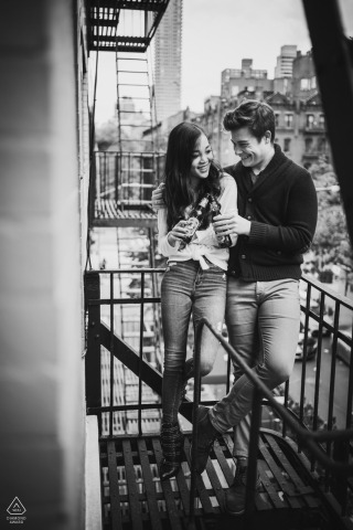 NYC Pre Wedding Photoshoot w Fine Art Style on an apartment fire escape while Having intimate time