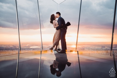 The Edge, NYC Artful Engagement Photography showing a reflected couple and their Kiss