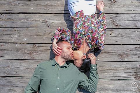 Noguera de la Sierpe, Cazorla Fine Art Pre Wedding Photograph shot overhead with couple lying down on wood deck