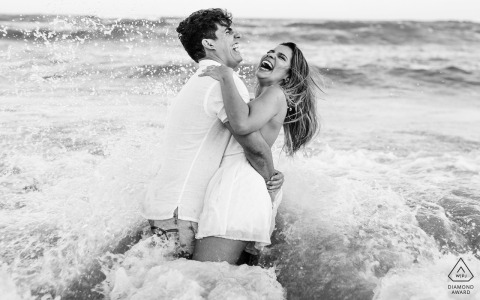 Maceió Artful Engagement Picture with the couple embraced and smiling at the sea