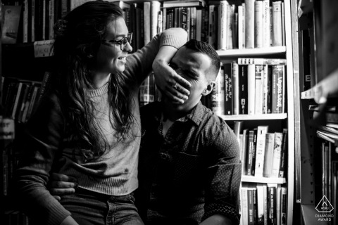 Capitol Hill, Washington DC Pre Wedding Photoshoot while The couple is laughing in a bookstore