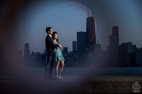 North Avenue Beach, Chicago Artful Engagement Photography with a couple the the skyline, framed