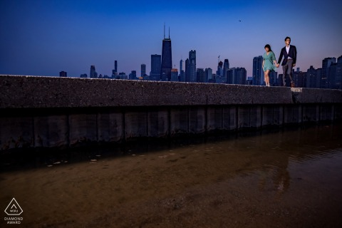 North Avenue Beach, Chicago Artful Engagement Picture for a couple walking in front of the skyline