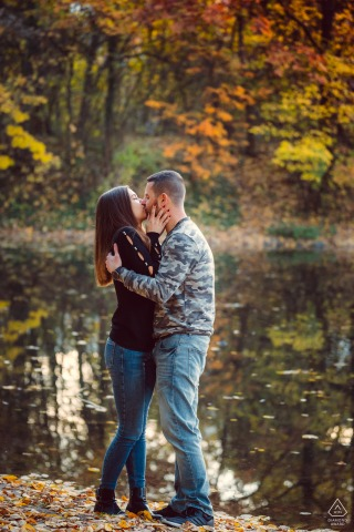Lake of the South Park, Sofia Fine Art Pre Wedding Portrait of the couple kissing by the water under the fall leaves