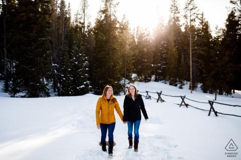 Breckenridge, CO portrait e-session of couple walking in  the snow