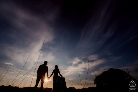 Buursezand, The Netherlands environmental engagement e-session of silhouetted couple at sunset
