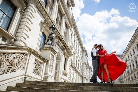 London on-location portrait e-shoot of urban buildings and lady in red