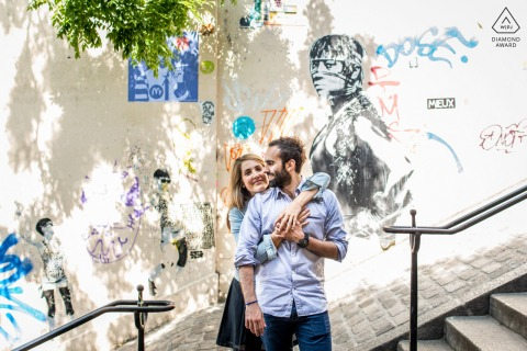 Paris portrait e-session on a set of stairs with art murals behind them on the wall