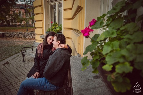 Sofia environmental engagement e-session of couple sitting on a bench
