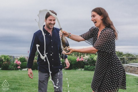 Nantucket, MA  on-location portrait e-shoot of a couple popping champagne to celebrate their engagement