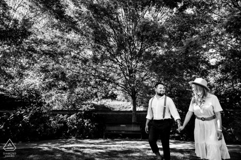 Volunteer Landing Park, TN environmental engagement e-session of a couple walking through the park as they hold hands