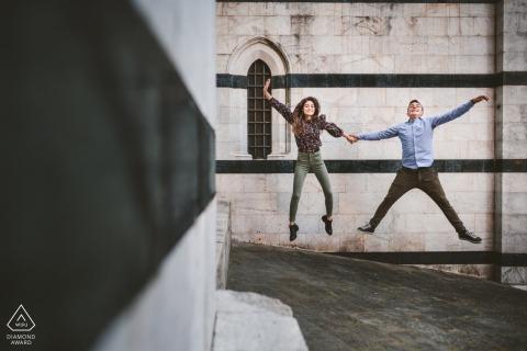 Piazza del Campo, Cortile del Podestà environmental engagement e-session - a couple jumping around Siena Cathedral