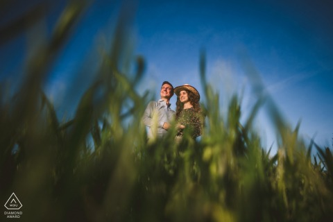 Crete Senesi, Siena environmental engagement e-session shot at a low angle in the grasses of Tuscany