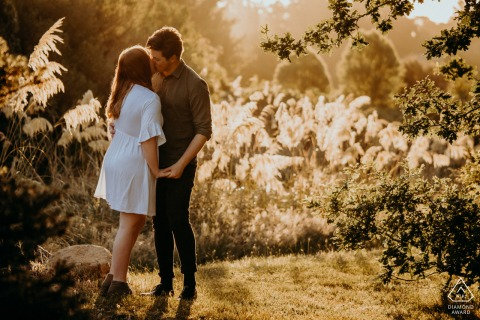 Halsweh Quarry Park Christchurch, NZ portrait e-session of a couple kissing at a sunset