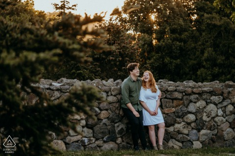 Halsweh Quarry Park Christchurch  portrait e-session - a couple relaxing by a stone wall