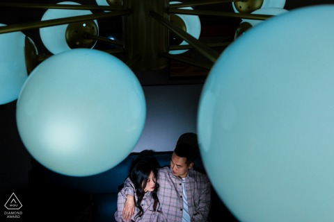 China portrait e-session with lit couple shot behind a light fixture
