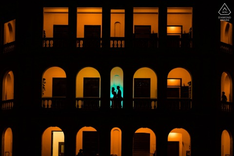 Hong Kong portrait e-session with creative lighting and couple silhouetted in archway