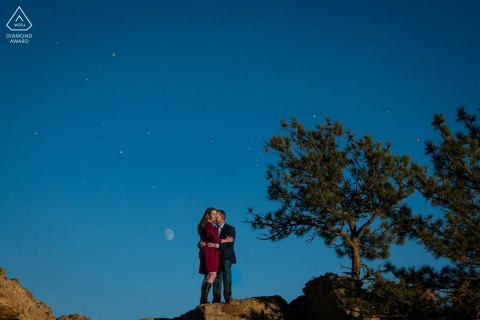 Horsetooth Reservoir, Fort Collins on-location portrait e-shoot - a couple stands on rock as sea gulls fly overhead