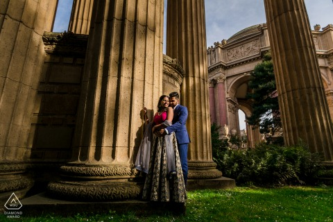 Palace of Fine Art, San Francisco, CA environmental engagement e-session Amongst Giant pillars on the grass with soft light