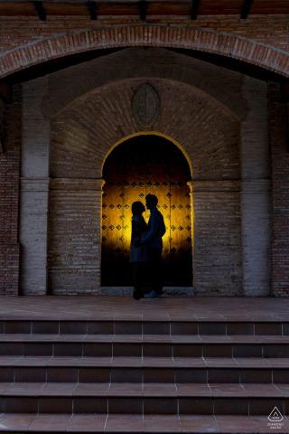 Ermita Virgen de la Cabeza, Cazorla, Spain portrait e-session above the steps in a lit archway